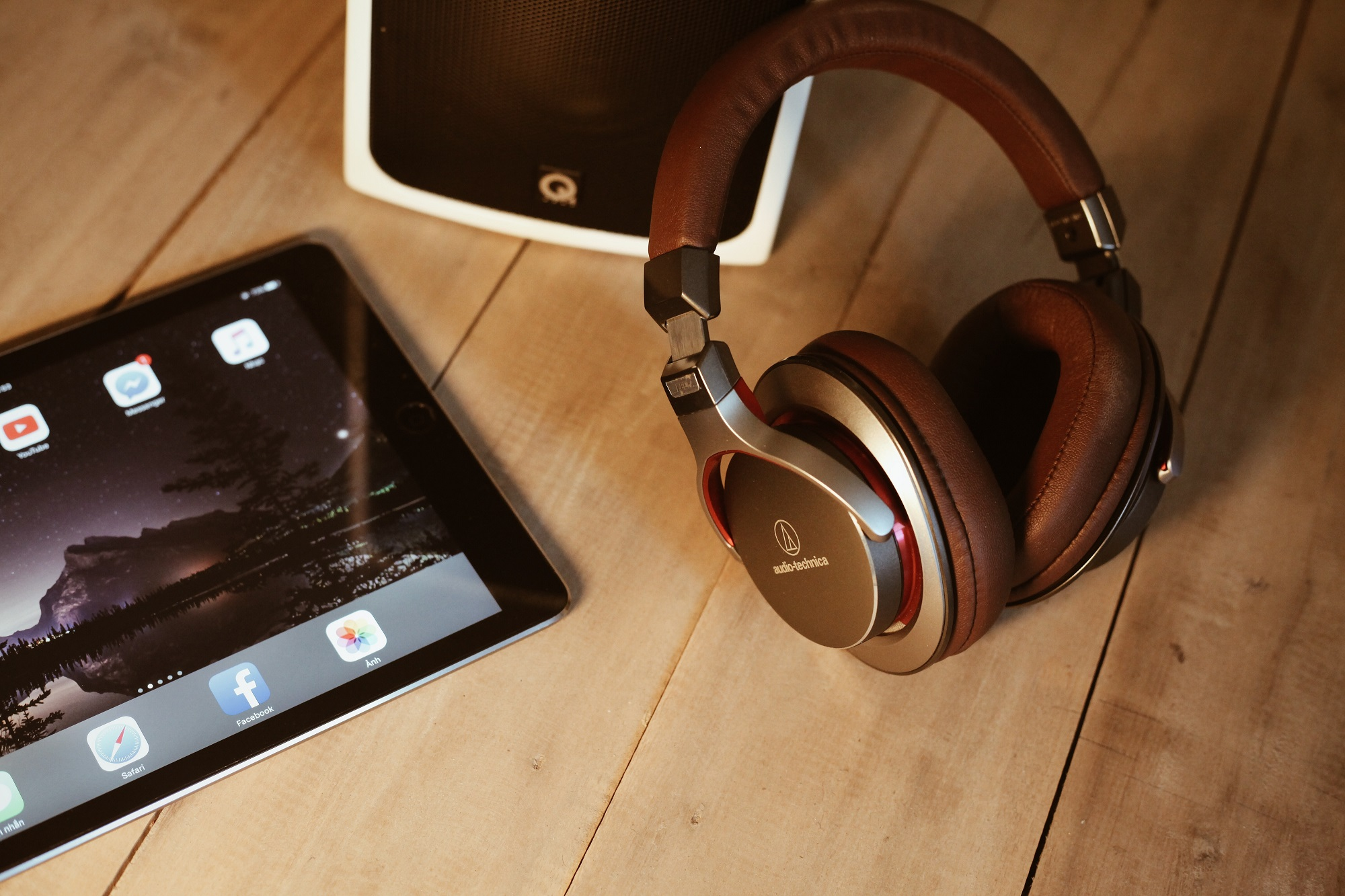 Photo of headphones and a tablet computer